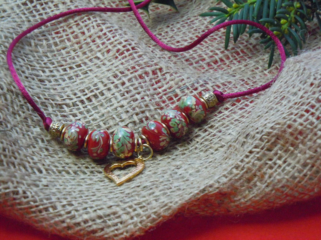 Gold plate Lampwork bead Necklace with Tierracast heart charm on silky cord