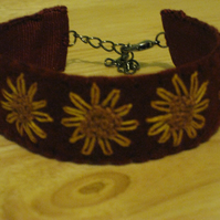 Lovely hand embroidered bracelet - cranberry felt with golden sunflowers