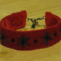 Pretty hand embroidered bracelet - red felt with black flowers and beads