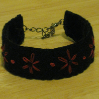 Lovely hand embroidered bracelet - black felt with pink flowers