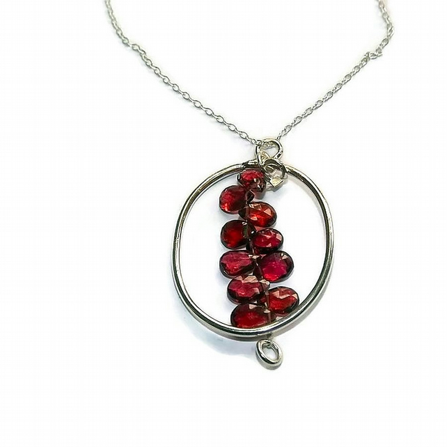 silver and garnet hoop pendant