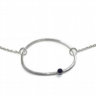 Sterling  silver oval hoop pendant set with rose cut lapis lazuli