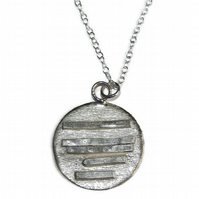 Fine silver handmade patterned disc pendant
