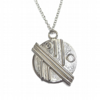 fine silver patterned disc pendant