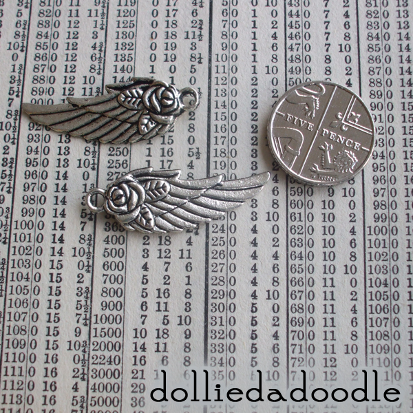 4 silver colured wing (flower) charms