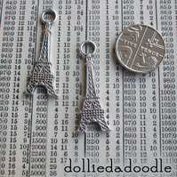 7 silver coloured Eiffel Tower charms