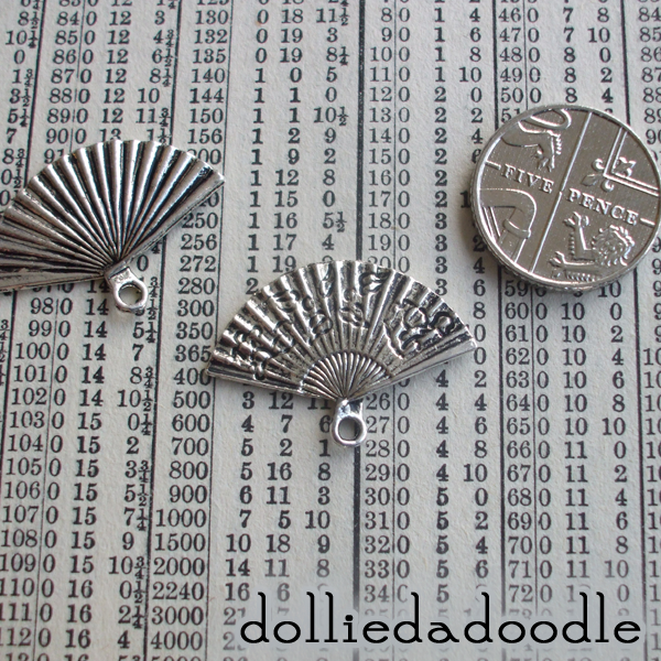 7 silver coloured fan charms