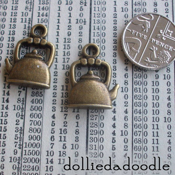 7 bronze coloured kettle charms