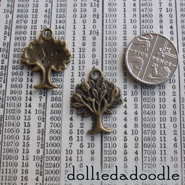 7 bronze coloured tree charms