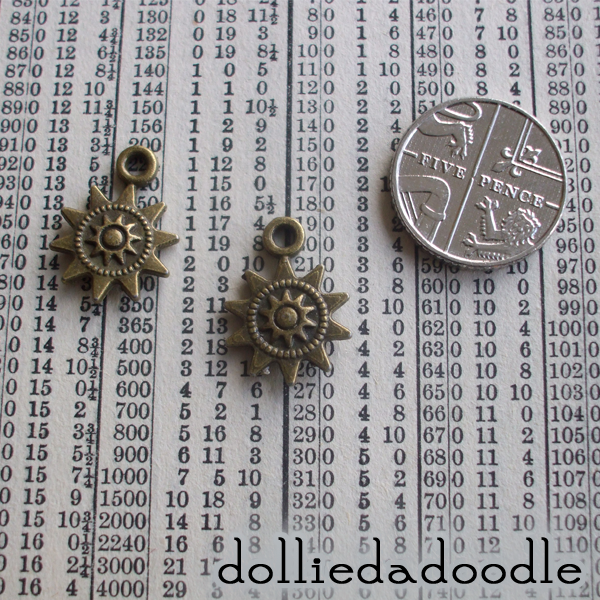 10 bronze coloured sun charms