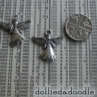 7 silver coloured angel charms