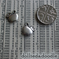 7 silver coloured apple charms