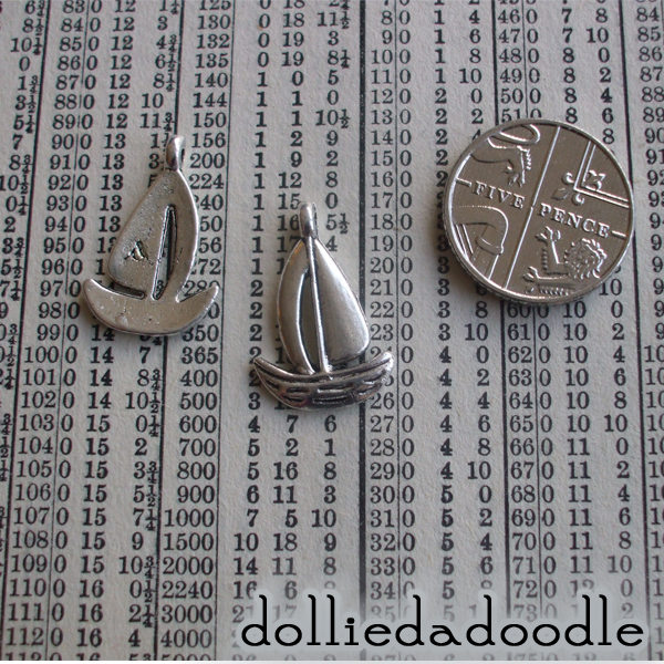 10 silver coloured boat charms