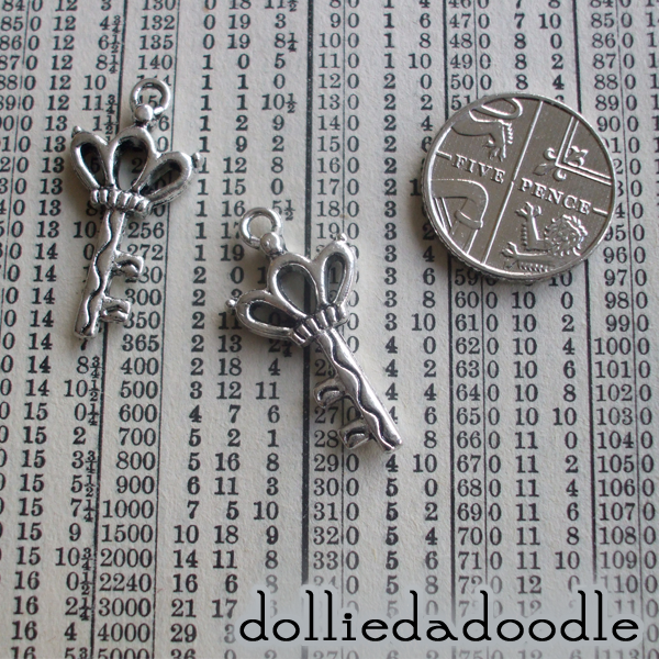 7 silver coloured key (crown) charms