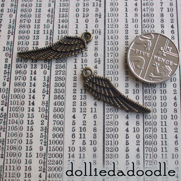 10 bronze coloured wing charms