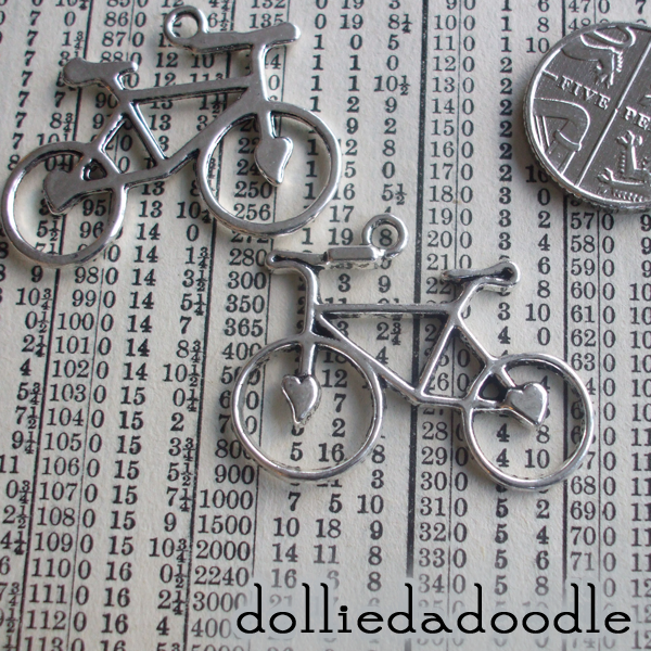 4 silver coloured bike charms