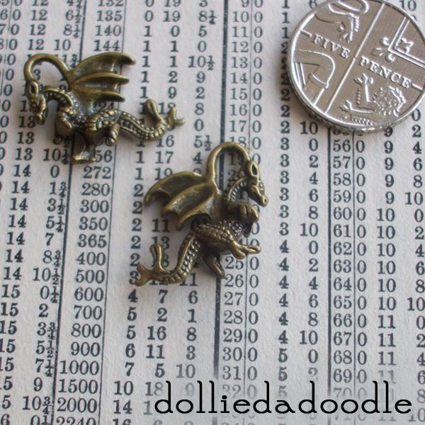 5 bronze coloured dragon charms