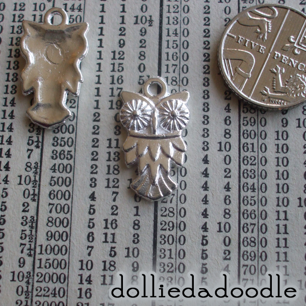 7 silver coloured owl charms
