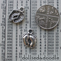 10 silver coloured baby feet charms