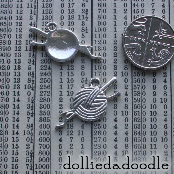 7 silver coloured knitting charms