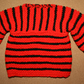 Black and red striped baby jumper