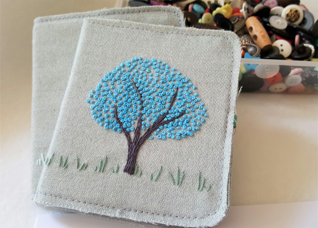 Embroidered needle case - blue blossoms