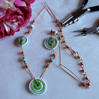 Copper and glass handmade necklace, with turquoise, green, white and cream glass