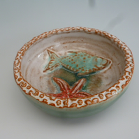 Small shallow ceramic pottery bowl