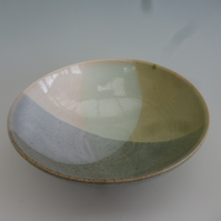 Small hand thrown bowl in pastel glazes