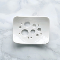 White ceramic soap dish in porcelain with bubble holes