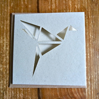 Card with origami style bird cut-out-pattern