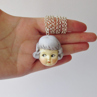 Dottie Dollie Blue Haired Rose Doll Face Pendant