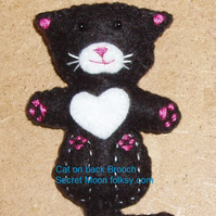 Cat on back Black Felt Brooch with white chest, muzzle