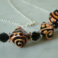 BLACK AND PEACH LAMPWORK NECKLACE - - FREE SHIPPING WORLDWIDE