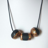 BLACK AND GOLD GLITTER POLYMER CLAY NECKLACE  - FREE UK POSTAGE