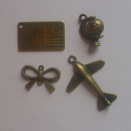 4 antique bronze tone charms globe bow postcard and aeroplane