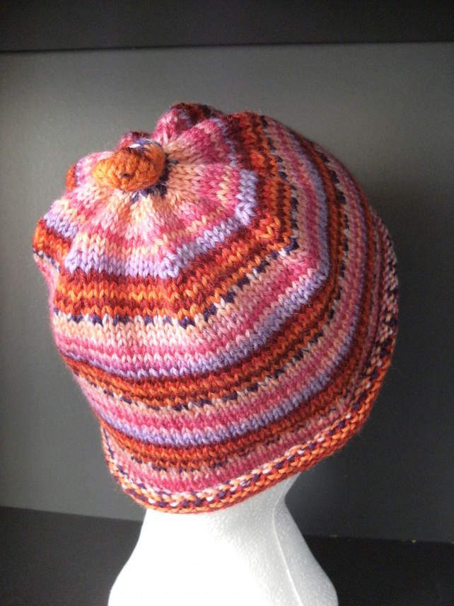 Handknit CHILDRENS 6-10 KNOTTY TOP BEANIE Stripey jacquard in Pinks & Reds