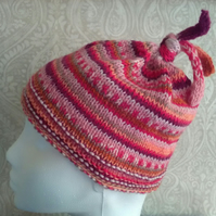 Handknit GIRL'S 3-5 TIE TOP BEANIE Stripey jacquard pinks oranges reds