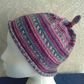 Handknit CHILDRENS 6-10 KNOTTY TOP BEANIE Stripey jacquard in Pink, purple, teal