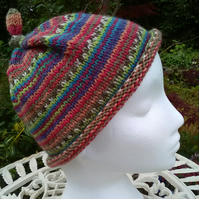 Handknit KNOTTY TOP BEANIE Stripey jacquard in reds blues multi child teen adult