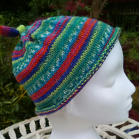 Handknit CHILDRENS 6-10 KNOTTY TOP BEANIE Stripey jacquard in multi brights