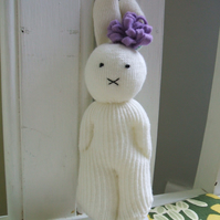 Cute bunny soft toy with lilac flower