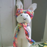 Cute bunny soft toy with rainbow scarf and hat