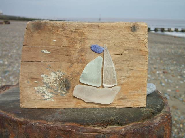 Seaglass and driftwood decoration - boat with a blue pennant
