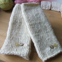 Hand knitted cream wool wrist warmers or fingerless gloves