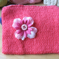 hand knitted small pink zipped purse with pink flower detail