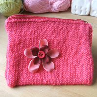 hand knitted small pink zipped purse with red flower detail
