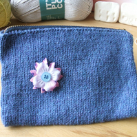hand knitted blue zipped purse or bag with button flower detail