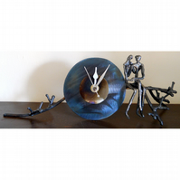 branch mantle clock with lovers sitting