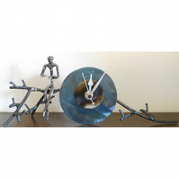 branch mantle clock with figure reading